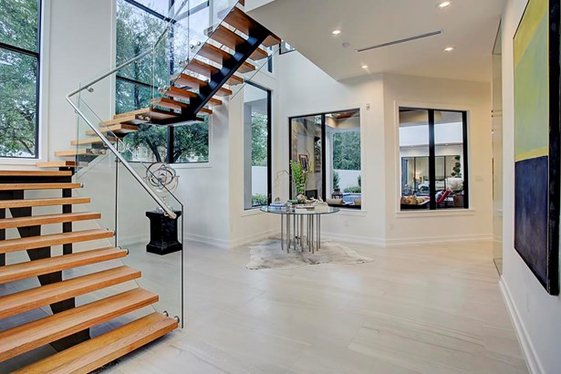 Custom finishes throughout, grand foyer features floating staircase, large expanses of floor to ceiling windows with abundant light with northern exposure. (photo 3)
