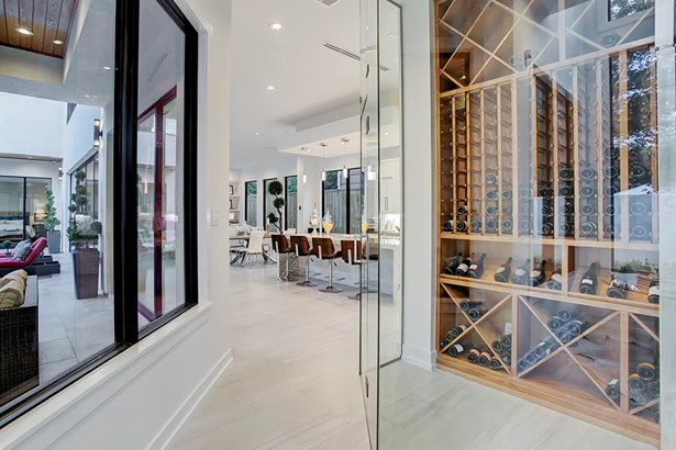 Enclosed wine room featuring wine display. (photo 5)