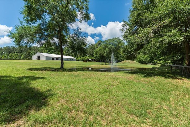 View of the Property on the left with the large 5+ acre pasture on the front; Show barn, arena, rear pasture and pond (photo 1)