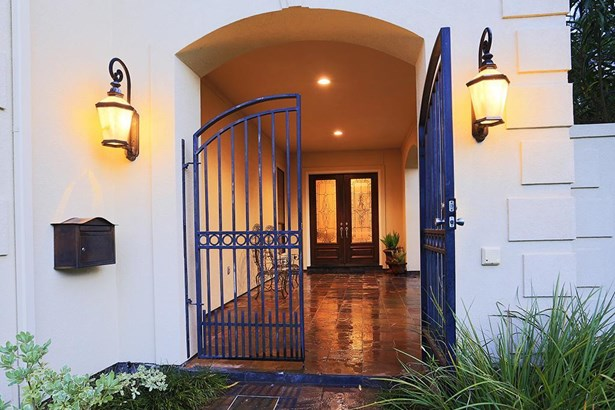 Double gate entry revealing the large side yard and beautiful front porch. (photo 2)