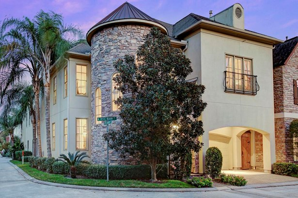 Tucked behind gates in the quiet and gated community of Hermann Lake you find this exquisite corner home surrounded by phenomenal manicured grounds. Corner parcel affording this residence abundant guest parking. (photo 2)