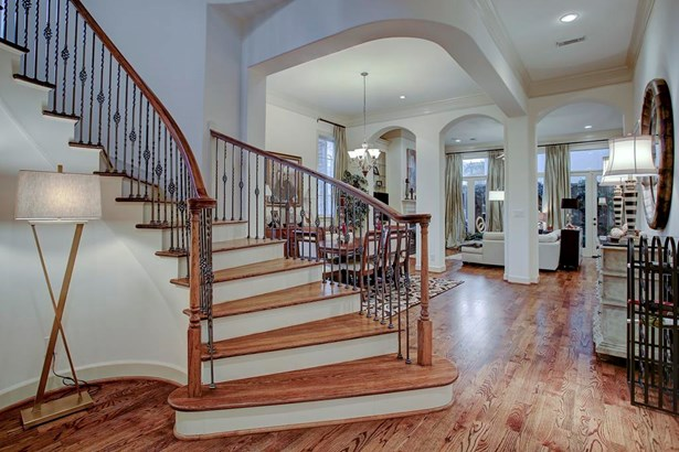 Upon entry you are greeted with a 2 story entry, handsome hardwoods and a gently winding staircase leading to the 2nd level. Open floor plan with spacious public rooms that lead seamlessly into each-other. High ceilings throughout. (photo 3)