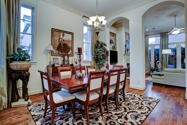Past the entry you find the spacious formal dining that is open to the grand living room. The spacious open floor-plan is designed for entertaining. Abundant windows throughout the spaces allow natural light throughout the interiors. (photo 5)