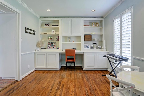 Great built-ins and recessed lighting with updated light fixture complete the space. (photo 4)