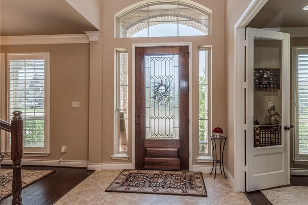 Two-story tile entry opens to the formal dining room on the left and the private study on the right. (photo 3)