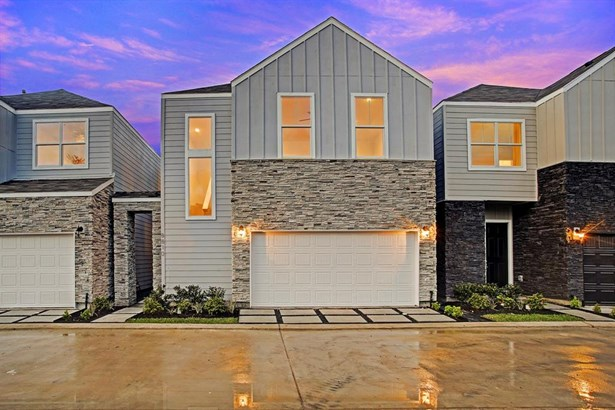 Welcome to Hollister Park - pictured here is The Bauer plan which features 3-4 bedrooms and 2.5 bathrooms on 2 levels. The main level features the public rooms consisting of living area with access to private yard and covered patio, kitchen and dining roo (photo 1)