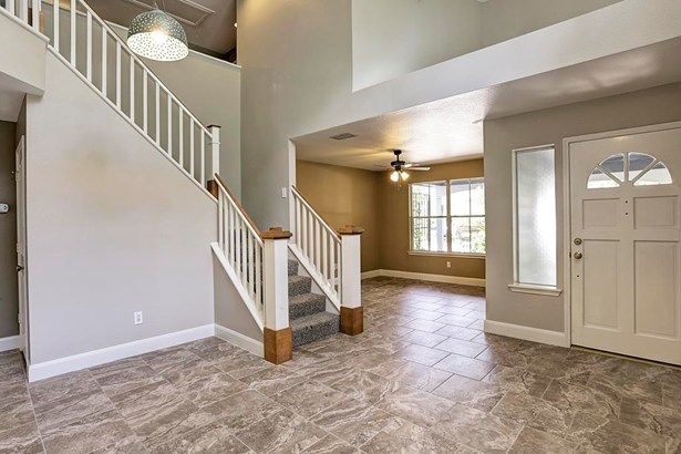 Entry looking onto flexible formal living room or study. (photo 2)