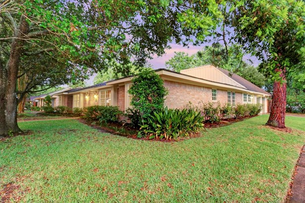 A huge corner lot at 9600 square feet with numerous trees and pool, this position within the isolated neighborhood allows quick access to major through streets. (photo 2)