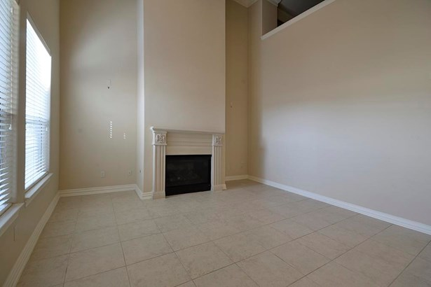 2 story den with fireplace (photo 3)