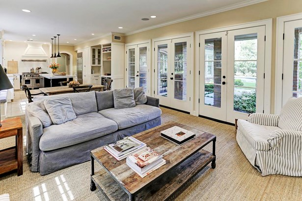 The family room with multiple French doors leading to the patio, pool and gardens...A wonderful open space that adjoins the kitchen (photo 5)
