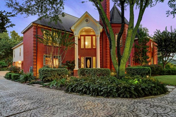Entry features two story columns, gas lanterns and beveled glass and wood door (photo 2)