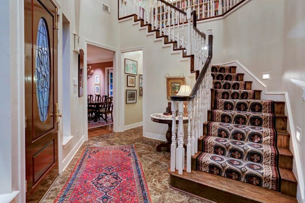 Grand two story entry with beautiful, winding staircase (photo 3)