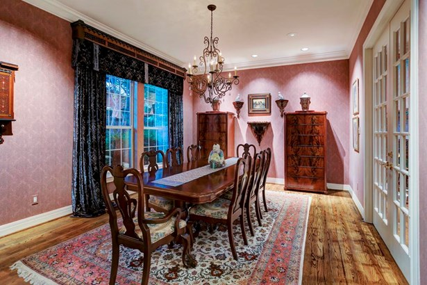 Large formal dining room with floor to ceiling windows overlooking front yard (photo 5)