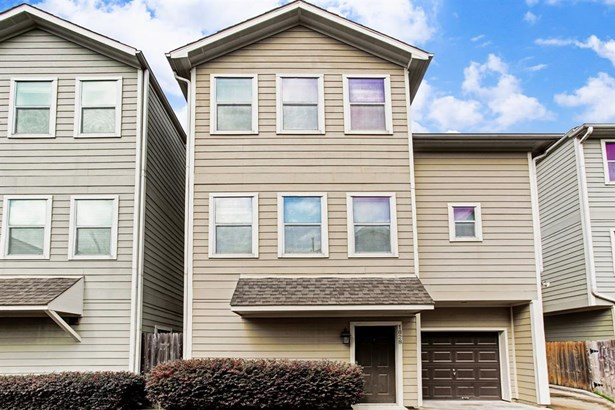 Meticulously maintained detached, three-story townhome nestled in a quiet, gated community with a strong HOA. (photo 1)