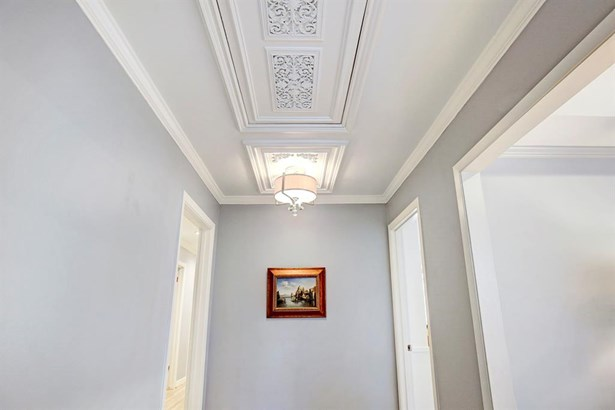 Look up and you will see Old Chicago architectural moldings that add interest to the Entry Hall. (photo 4)