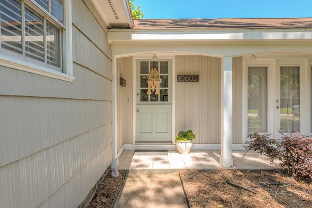 The covered front porch with split-level door creates a warm and inviting entrance into the home. (photo 2)