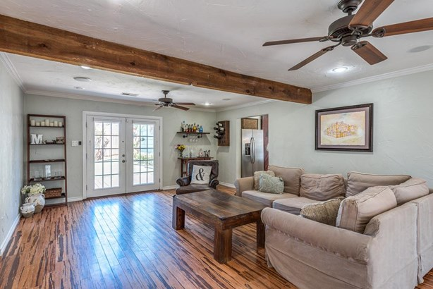 Open and light den with 2 ceiling fans and double French doors which open to the back yard. (photo 4)