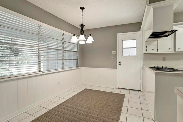 Breakfast room with wall of window and tile floors. (photo 5)