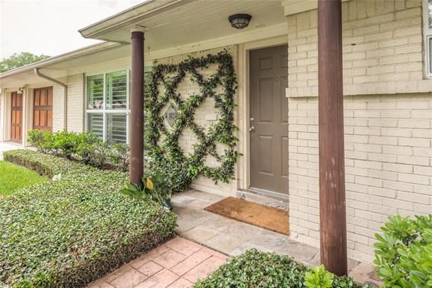Covered front entrance with side columns and large front windows greets your arriving guests into a most inviting family home! (photo 3)