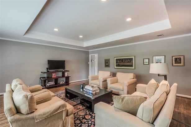 Spacious living room with elevated tray ceiling, recessed lighting and gorgeous wood floors. (photo 5)