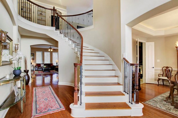 The 21 foot entry impresses with wood floors and chandelier. (photo 3)
