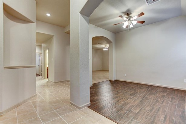 Formal dining room is found upon entrance and contains wood tile flooring as well as high ceiling vaults. Formal dining room can also be used as a study or work out area. (photo 2)