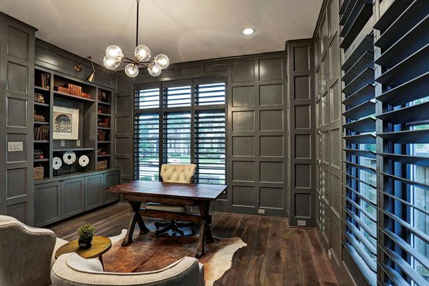 The study features square block paneling, 6 light chandelier, built-in bookcases with adjustable scone lighting and plantation shutters. (photo 3)