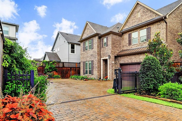 Welcome to this beautiful home in the gated community of prestigious Bracher Estates! Located on a cul-de-sac street, notice the additional gate and motor court parking.