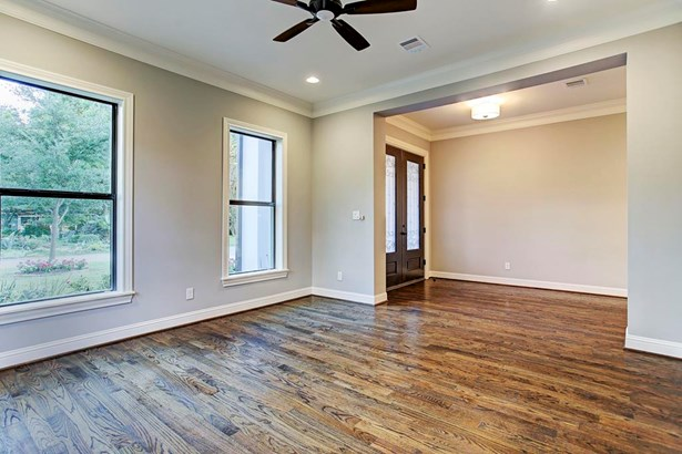 The study, just off the main entryway. Abundant natural light, warm hardwood floors and custom molding. (photo 4)