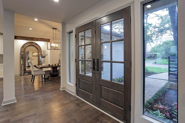 Dramatic entry with double solid wood and glass doors, hickory engineered wood floors throughout most of home (photo 4)