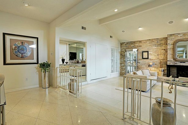 Another view showing the wet bar opens on either side, perfect for entertaining! (photo 5)