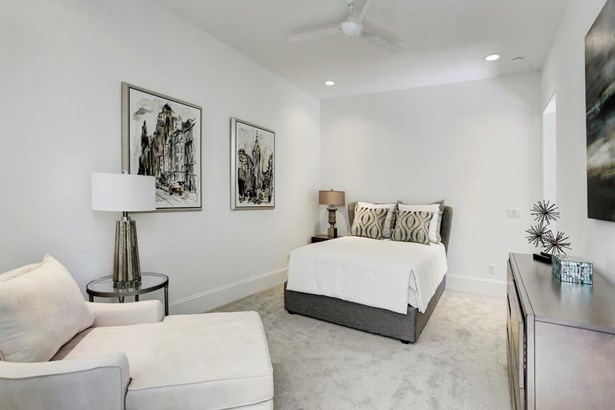 1st floor bedroom is large enough to accommodate large furniture or a separate seating area. Full privacy in this 1st floor room w/ ensuite bathroom and large closet. (photo 2)