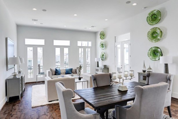 The dining space is adjacent to the kitchen, perfect for entertaining family and guests. Currently staged, we have a 4 person table, but the space is plenty large enough for a much bigger dining table. (photo 5)