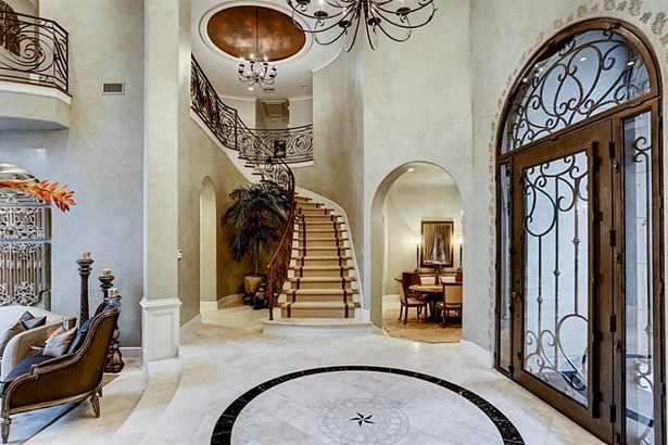 Entry with inlaid marble flooring, grand iron railed staircase and lofty domed ceiling (photo 5)