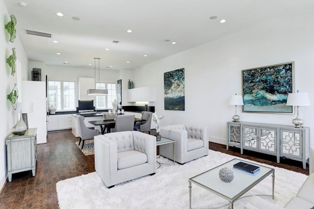 Welcome to luxury living! Soaring 12 foot ceilings on the Kitchen & Living level, something you won t find in other near-by communities. There is also more than enough recessed lighting throughout. (photo 3)