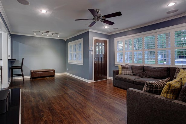 Upon entry you are welcomed into the living area with hardwood floors. Recessed lighting and speakers are just some of the features that bring this 1950's remodeled ranch to todays era. (photo 4)