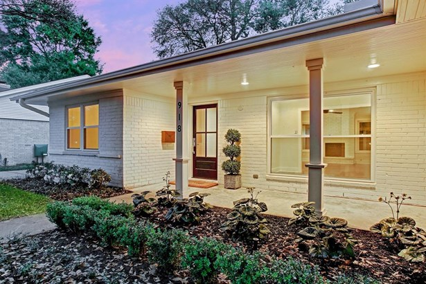 Beautiful landscaping includes boxwoods, white azaleas and pops of color. Front porch is lit with recessed lighting and divided light front door offers Baldwin hardware. (photo 2)