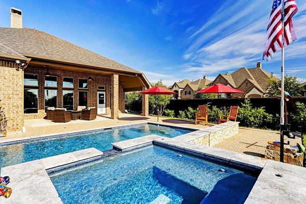 This home is an entertainers dream. It features 4-5 bedrooms, 3.5 baths, a resort style backyard with pool, spa and covered patio and a 3-car oversized garage. The home is situated on an 11,528 square foot corner lot in Pine Mill Ranch. (photo 1)