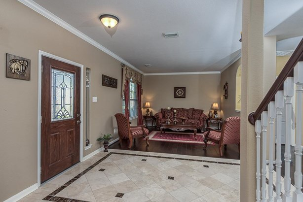 Stone tile entry area opens to formal living and dining on each side, great for entertaining! (photo 3)