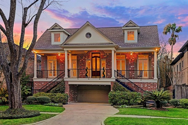 Beautiful traditional with expansive, one of a kind, porch overlooking beautiful tree-lined street (photo 1)
