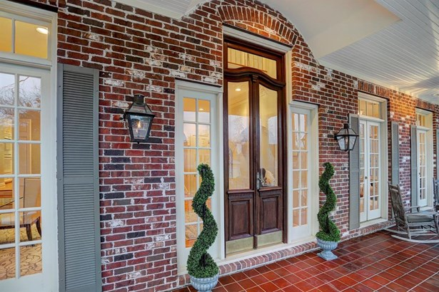 Inviting front porch runs the length of the house and offers a great place to relax or entertain (photo 4)