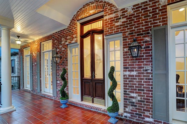 Another angle of the porch, French doors open up to allow for great entertaining, porch is large enough to accommodate outdoor dining (photo 5)