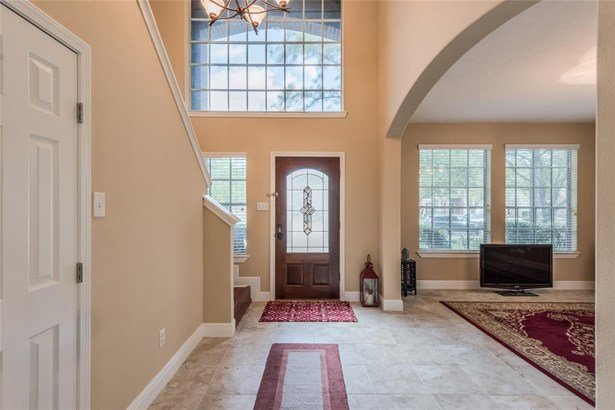 Two-story entry with tile floors and large upper window providing enormous light into the space. (photo 3)
