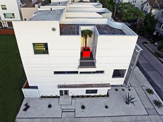 Aerial view of home featuring the palm tree and expansive terrace (photo 5)