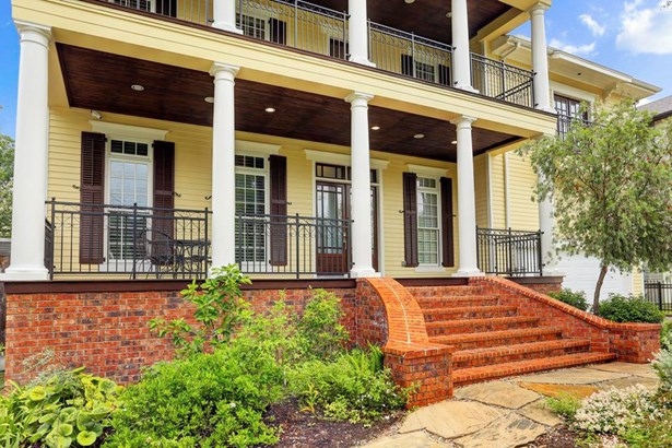 Two large front porches to relax on and enjoy the landscaped yard and quiet street. There are Klipsch stereo speakers in the ceiling on both these porches too. (photo 2)