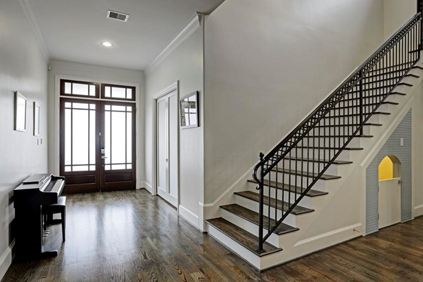 A nice wide entry with crown molding, high baseboards and beautiful solid oak floors which are throughout the house. The handsome double 8 front doors have beautiful frosted glass. (photo 3)