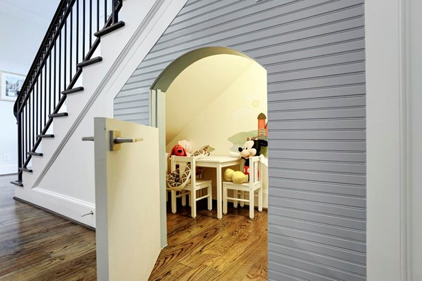 Under the staircase is a wonderful child s hide-a-way play area. (photo 4)
