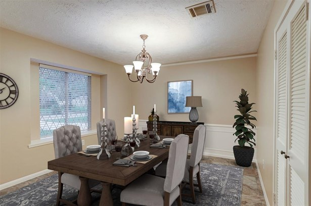 Formal dining room with box window, chair railing, picture frame molding, high end tile floors and an oil rubbed bronze candelabra. (photo 5)