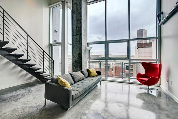 Modern, yet refined loft boasting amazing spaces, abundant light and gorgeous views of downtown s magnificent skyline. Located on the 7th floor of Midtown s Rise Lofts, this is urban living at its best. (photo 2)