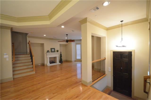 Looking from the dining room into the family room shows the openness of this floor plan. (photo 3)